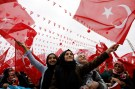 Supporters of Turkish President Erdogan wave national flags during a rally for the upcoming referendum in the Black Sea city of Rize