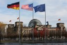 German, U.S. and EU flags fly in front of the Reichstag building ahead of the meeting between U.S. President Obama and German Chancellor Merkel in Berlin