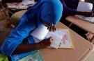 """Zeinab, 14, writes in class at a school near a camp for internally displaced people from drought hit areas in Dollow, Somalia April 3, 2017. REUTERS/ Zohra Bensemra    SEARCH """"ZEINAB DOLLOW"""" FOR THIS STORY. SEARCH """"WIDER IMAGE"""" FOR ALL STORIES. - RTX34W48"""