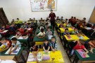 Refugee schoolchildren attend in a classroom on the first day of the new school year at one of UNRWA schools in of Palestinian refugee camp in Amman