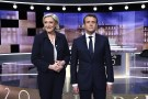 Candidates for the 2017 presidential election, Emmanuel Macron (R), head of the political movement En Marche !, or Onwards !, and Marine Le Pen, of the French National Front (FN) party, pose prior to the start of a live prime-time debate in the studios of French television station France 2, and French private station TF1 in La Plaine-Saint-Denis, near Paris, France, May 3, 2017. REUTERS/Eric Feferberg/Pool - RTS150ZP