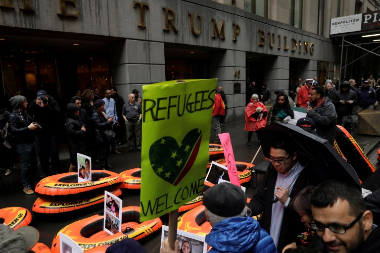 Protesters gather outside the Trump Building at 40 Wall St. to take action against America's refugee ban in New York City, U.S., March 28, 2017. REUTERS/Lucas Jackson - RTX333GZ