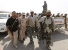 Head of the Badr Organisation Hadi al-Amiri (C, L) walks with Shi'ite fighters in Makhoul mountains, north of Baiji, October 17, 2015. Iraqi forces and Shi'ite militia fighters recaptured most of the country's largest oil refinery from Islamic State militants on Thursday, security officials said. The report could not be independently confirmed because it is too dangerous for journalists to enter the battle zone around the refinery near the town of Baiji, about 190 km (120 miles) north of Baghdad.