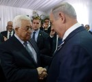 Palestinian President Mahmoud Abbas shakes hands with Israeli Prime Minister Benjamin Netanyahu