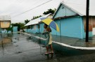 A resident of Port Royal walks in an empty street before the arrival of Hurricane Dean in Kingston, Jamacia August 19, 2007.Hurricane Dean bore down on Jamaica and the Cayman Islands on Sunday and threatened to pound Mexico's Yucatan Peninsula as a rare Category 5 storm. REUTERS/Carlos Barria (JAMAICA) - RTR1SWNT