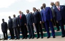 L-R Front Row: Nigeria's Vice-President Yemi Osinbajo, Kenya's President Uhuru Kenyatta, Guinea's President Alpha Conde, U.S. President Donald Trump, Italian Prime Minister Paolo Gentiloni, French President Emmanuel Macron, Niger's President Mahamadou Issoufou and Tunisian President Beji Caid Essebsi pose for a family photo with other participants of the G7 Summit expanded session in Taormina, Sicily, Italy May 27, 2017. REUTERS/Jonathan Ernst