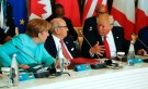 U.S. President Donald Trump talks to German Chancellor Angela Merkel (L) and Tunisia's President Beji Caid Essebsi (2-L) at the G7 Summit expanded session in Taormina, Sicily, Italy May 27, 2017. REUTERS/Jonathan Ernst