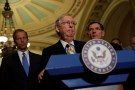 Senate Majority Leader Mitch McConnell, accompanied by Sen. John Barrasso (R-WY) and Sen. John Thune (R-SD), speaks to the media about plans to repeal and replace Obamacare on Capitol Hill in Washington, U.S., June 27, 2017. REUTERS/Aaron P. Bernstein - RTS18VLY