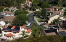 Multiple homes with solar panels are shown in Scripps Ranch, San Diego, California, U.S.