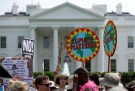 rotesters carry signs during the Peoples Climate March at the White House in Washington