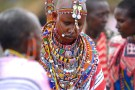 Maasai bride Baiera wears traditional bead necklaces during her wedding in Olepolos village