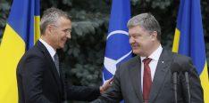 NATO Secretary General Jens Stoltenberg and Ukrainian President Petro Poroshenko shake hands during a joint news conference following a meeting of the NATO-Ukraine Commission in Kyiv, Ukraine, July 10, 2017. REUTERS/Valentyn Ogirenko - RTX3ATLR