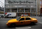 A taxi passes by in front of The New York Times head office in New York, February 7, 2013.  REUTERS/Carlo Allegri/File Photo                 GLOBAL BUSINESS WEEK AHEAD PACKAGE - SEARCH 'BUSINESS WEEK AHEAD 31 OCT'  FOR ALL IMAGES - RTX2R4RK