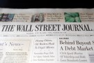 "A copy of the Wall Street Journal is pictured in a newsstand in New York, June 26, 2007. Rupert Murdoch's News Corp. and Dow Jones & Co. Inc. have ""basically agreed"" on a structure to protect the editorial independence of Dow Jones' news operations, a source familiar with the matter said on Tuesday. News Corp. is offering $5 billion to buy Dow Jones.  REUTERS/Keith Bedford (UNITED STATES) - RTR1R6CD"