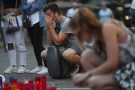 A man reacts at an impromptu memorial where a van crashed into pedestrians at Las Ramblas in Barcelona, Spain August 21, 2017. REUTERS/Susana Vera - RC197DA58290