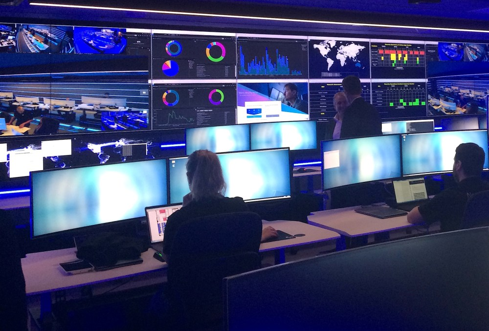Employees can be seen in the Security Operation Centre for Telstra, Australia's biggest telecoms firm, which is used to monitor, detect and respond to security incidents, including cyber attacks, during a media event in central Sydney, Australia, August 24, 2017. REUTERS/Tom Westbrook - RTS1D3F6