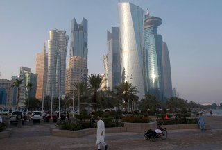 A man walks on the corniche in Doha, Qatar,