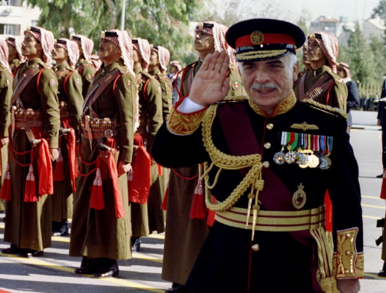 Jordan's King Hussein reviews Bedouin guards of honour at the oficial opening of the country's new parliament in Amman November 23 after the results of November 13 - RTXEUVB