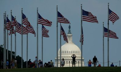 Flags fly at the Washington Monument, as the U.S. Capitol is seen at rear, on Flag Day in Washington, U.S., June 14, 2017. REUTERS/Joshua Roberts - RTS174ST