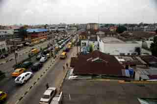 A view of the Yaba district in Lagos June 25, 2015. At first glance, Yaba is like many other parts of Nigeria's sprawling commercial capital: a cacophony of car horns and shouting street vendors, mingling with exhaust fumes and the occasional stench of sewage. But in between the run-down buildings in this seemingly inauspicious part of Lagos, a city of around 21 million, tech start-ups are taking root and creating a buzz that is drawing international venture capitalists and more established digital firms. Picture taken June 25, 2015. REUTERS/Akintunde Akinleye - RTX1M6LS