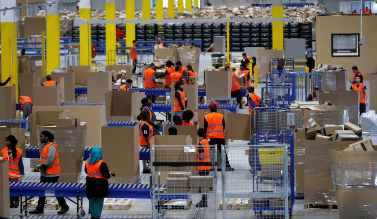 Employees work at the Amazon distribution center warehouse in Saran, near Orleans, France, November 22, 2016. REUTERS/Philippe Wojazer - RC14E99D05A0
