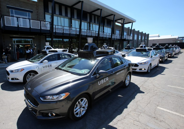 A row of autonomous vehicles.