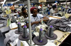 Kenyan workers prepare clothes for export at the Alltex export processing zone (EPZ) factory in Athi River, near the Kenyan capital Nairobi, July 31, 2009. Kenya's exports to the United States rose 8 percent to 20.6 billion shillings ($268 million) in 2008, largely due to U.S. legislation to promote African trade, Kenya's trade minister Amos Kimunya said. The U.S. African Growth and Opportunity Act (AGOA) has granted duty-free access for many sub-Saharan African nations' products since 2000. REUTERS/Thomas Mukoya (KENYA BUSINESS EMPLOYMENT) - GM1E57V1PAB01