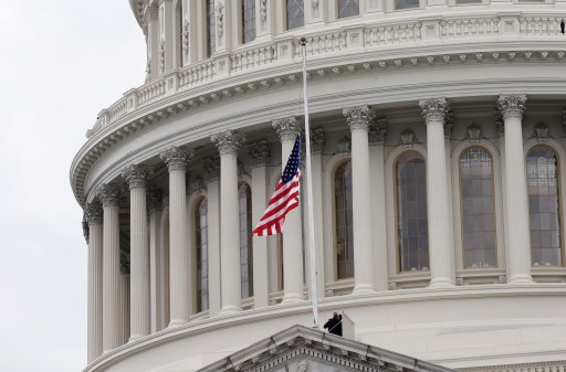 The American flag is changed for a new one on the Capitol building during inauguration ceremonies swearing in Donald Trump as the 45th president of the United States on the West front of the U.S. Capitol in Washington, U.S., January 20, 2017. REUTERS/Mike Segar - HT1ED1K1E2RCE