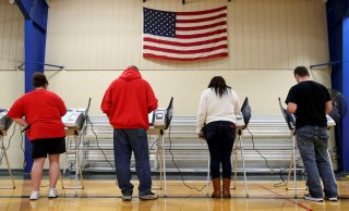 Voters cast their votes during the U.S. presidential election in Elyria, Ohio, U.S. November 8, 2016. REUTERS/Aaron Josefczyk/File Photo - TM3ECBA16K501