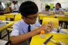 A student assembles a model aeroplane during an enrichment class at a secondary school in Singapore October 27, 2016. Picture taken October 27, 2016. REUTERS/Edgar Su - RC17C9D176C0
