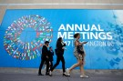 Delegates leave International Monetary Fund headquarters in the end of the day during the IMF/World Bank annual meetings in Washington, U.S., October 14, 2017. REUTERS/Yuri Gripas - RC1B86F96950