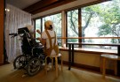"A carer feeds a resident on a wheelchair at the private nursing home ""Silver Villa Koyama"" in Tokyo, Japan, September 14, 2016. Picture taken on September 14, 2016.  REUTERS/Kim Kyung-Hoon - S1BEUDZWMJAA"