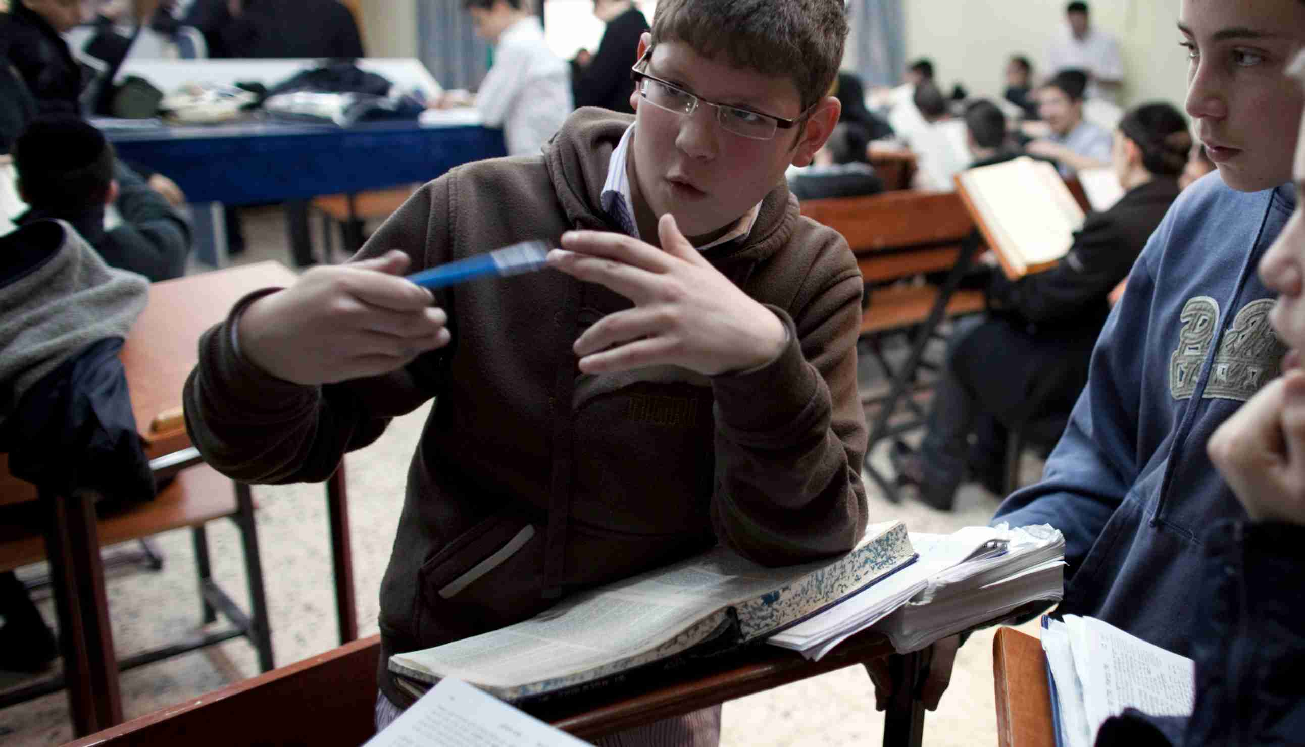 Ultra-Orthodox Jewish pupils discuss the Bible at the Nahardea school in Nehalim near Tel Aviv January 26, 2010. Inside a modern economy renowned for its innovative high-tech sector, they see a growing problem. Critics say the Jewish pupils who attend ultra-Orthodox schools can recite chapter and verse of the Bible, but most can't spell the name of their largest Arab neighbour, Egypt, in English. Picture taken January 26, 2010. To match feature ISRAEL/EDUCATION REUTERS/Darren Whiteside (ISRAEL - Tags: EDUCATION RELIGION) - GM1E62G19C901