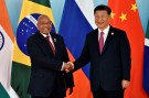 Chinese President Xi Jinping (R) and South Africa's President Jacob Zuma shake hands before the group photo during the BRICS Summit at the Xiamen International Conference and Exhibition Center in Xiamen, southeastern China's Fujian Province, China September 4, 2017. REUTERS/Kenzaburo Fukuhara/Pool - RC12CBC6B5B0