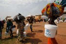 People displaced by the recent unrest, collect food distributed by aid agencies at an IDP camp at the Mpoko international airport of Bangui February 12, 2014. The United Nations estimates that 1.3 million people - more than a quarter of the population - are in need of urgent food aid after months of communal violence that French and African peacekeepers have been unable to stop.  REUTERS/Luc Gnago (CENTRAL AFRICAN REPUBLIC - Tags: POLITICS CIVIL UNREST) - GM1EA2D01YD01