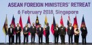 Foreign ministers prepare to pose for a group photo at the Association of Southeast Asian Nations (ASEAN) Foreign Ministers' Meeting retreat in Singapore February 6