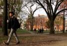 A man walks through Harvard Yard at Harvard University.