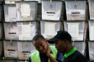 Independent Electoral and Boundaries Commission (IEBC) officials talk near stacked ballot boxes at a tally centre in Nairobi, Kenya October 27, 2017. REUTERS/Siegfried Modola - RC1CFF35E710