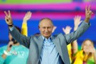 Russian President Vladimir Putin waves to participants of the 19th World Festival of Youth and Students during the closing ceremony at the Olympic Park in Sochi, Russia October 21, 2017. REUTERS/Alexander Zemlianichenko/Pool TPX IMAGES OF THE DAY - RC13EB6A1380
