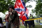 A white nationalist carries the Confederate flag as he arrives for a rally in Charlottesville, Virginia, U.S., August 12, 2017.   REUTERS/Joshua Roberts - RC14FA787A00