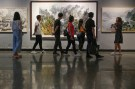 Visitors look at works by North Korean artists at the Mansudae Art Museum in Beijing