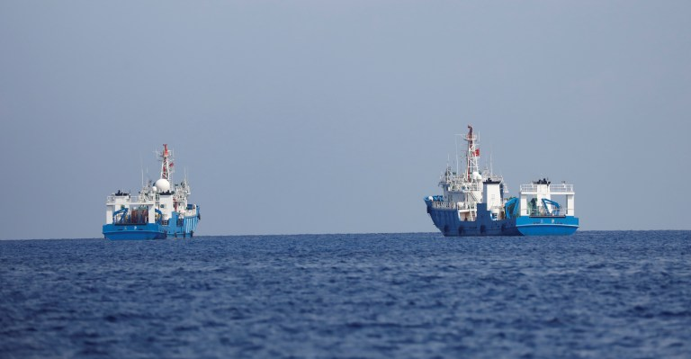 Chinese vessels are pictured at the disputed Scarborough Shoal April 6, 2017. Picture taken April 6, 2017. REUTERS/Erik De Castro - RC1C6DD1BC60