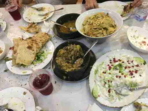 "After a walk through Jizan's central souk (market), another amazing Yemeni-style dinner. In the souk, a little boy begged me for change; locals dismissed him, telling me, ""huwa min Yemen"" (""he's from Yemen""). A local told me that there is child trafficking into Jizan from Yemen. I did not see evidence of a major refugee inflow (e.g. homeless or begging families in the souk), and locals spoke of cross-border migration as a longstanding feature of life here—indeed, some locals trace their ancestry to Yemen."