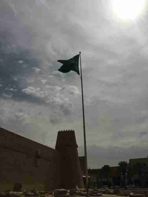 The Saudi flag flies over Masmak Fort in the center of Riyadh. Abdelaziz Al-Saud's secret return from Kuwait to capture Masmak Fort in 1902 is seen as a key event in establishing the modern Saudi kingdom. The incident is extensively documented in the Fort's permanent exhibit, including by a 1950s-era, ARAMCO-produced film that dramatically recreates the story.