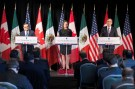 Chrystia Freeland (C), Canada's Minister of Foreign Affairs, speaks to the press with Ildefonso Guajardo (L),  Mexico's Secretary of Economy, and Robert Lighthizer (R), United States Trade Representative, in Montreal, Quebec, Canada January 29, 2018. REUTERS/Christinne Muschi - RC1672775C10