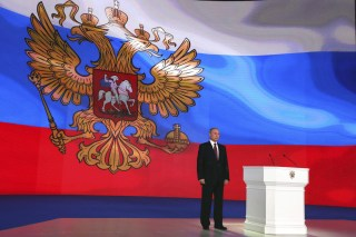 Russian President Vladimir Putin stands on the stage as he addresses the Federal Assembly, including the State Duma parliamentarians, members of the Federation Council, regional governors and other high-ranking officials, in Moscow, Russia March 1, 2018. Sputnik/Mikhail Klimentyev/Kremlin via REUTERS ATTENTION EDITORS - THIS IMAGE WAS PROVIDED BY A THIRD PARTY. - UP1EE310W85R3