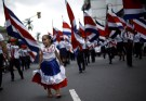 A girl wearing a dress with the colours of Costa Rica's flag takes part in a parade to commemorate Costa Rica's Independence Day in San Jose, Costa Rica, September 15, 2016. REUTERS/Juan Carlos Ulate - S1BEUBMSKTAB
