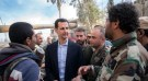 Syrian President Bashar al-Assad meets with Syrian army soldiers.