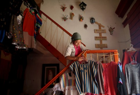 """Soraya, 25, a Muslim from the Tzotzil Maya ethnic group, works at the craft store in San Cristobal de las Casas, in Chiapas state, Mexico, August 11, 2017. REUTERS/Edgard Garrido  SEARCH """"TZOTZIL MAYA"""" FOR THIS STORY. SEARCH """"WIDER IMAGE"""" FOR ALL STORIES. - RC181D43AD80"""