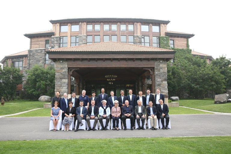 Participants pose for a photo during the third U.S.-China Leaders Forum, hosted by the Brookings John L. Thornton China Center and The Annenberg Foundation Trust at Sunnylands at the Diaoyutai State Guesthouse and Jinhai Lake Resort in Beijing, China, from May 11 to May 13, 2018.
